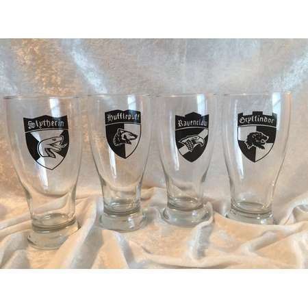 Harry Potter four piece set of 16oz Pint Glasses in four Houses, Hufflepuff, Griffindor, Ravenclaw and Slytherin thumb