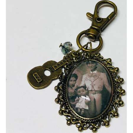 Rivera Family Portrait Hector and Imelda Small Oval Cameo Brooch Keychain or Necklace. Disney Pixar Coco Storybook Jewelry thumb